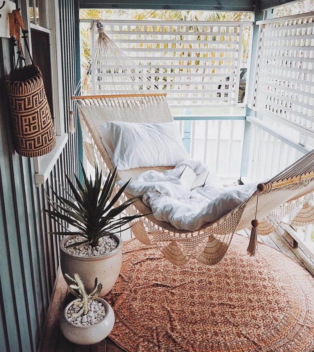 A chic hammock on a boho balcony
