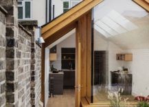 A-difference-in-flooring-along-with-height-delineates-the-garden-from-the-extension-217x155