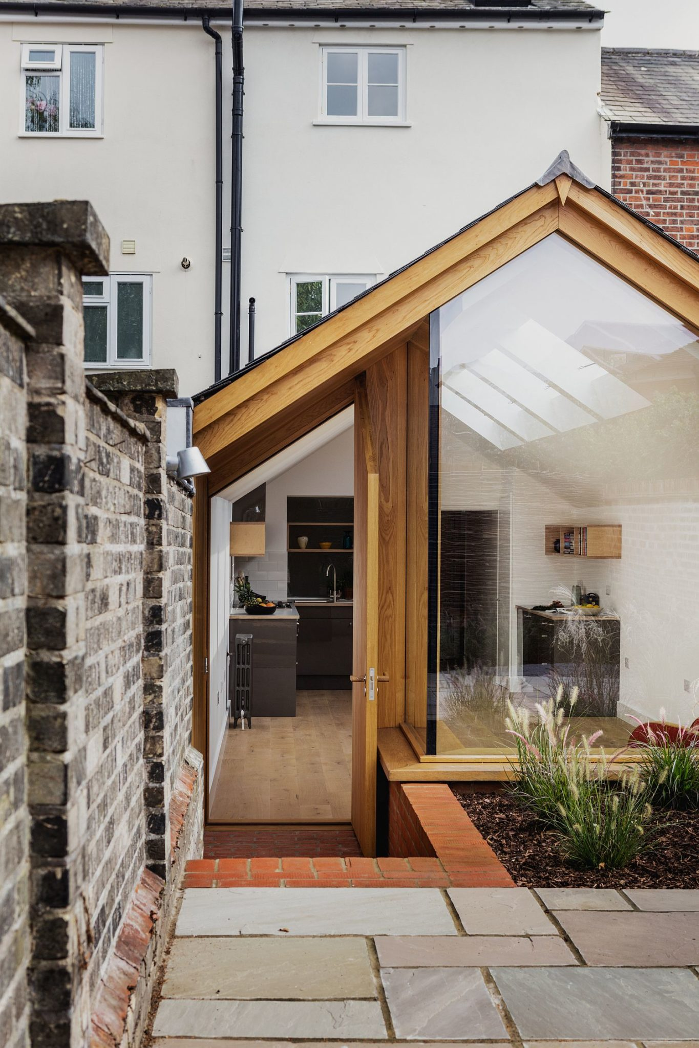 A-difference-in-flooring-along-with-height-delineates-the-garden-from-the-extension
