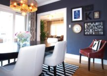 A-dim-contemporary-dining-room-with-a-monochrome-dinner-table-rug-217x155