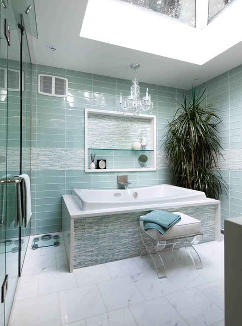 A light turquoise bathroom with a sophisticated look