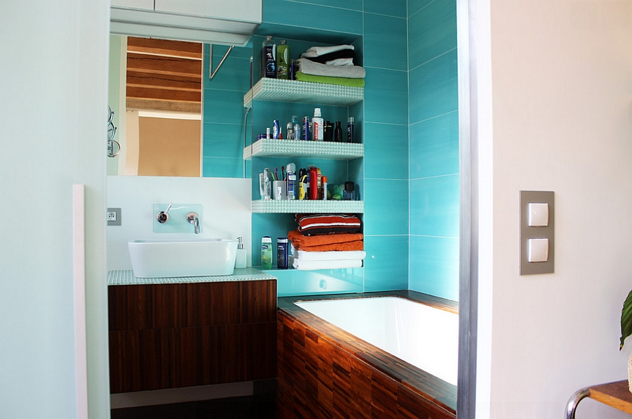 A small bathroom with a turquoise interior