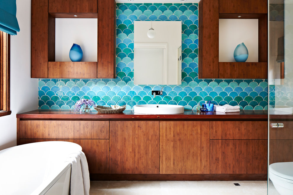 Bathroom with turquoise tiles that resemble fish scales