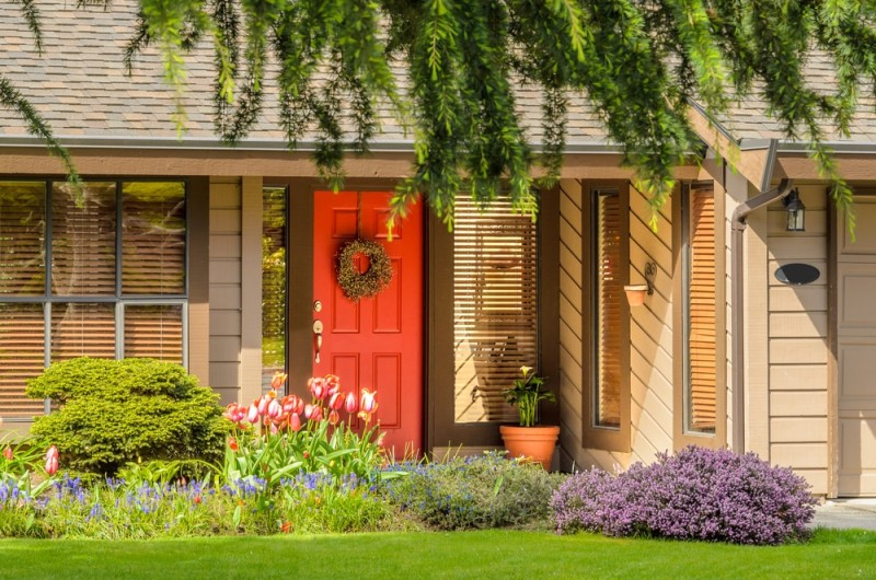 Beautiful red door with a wreath