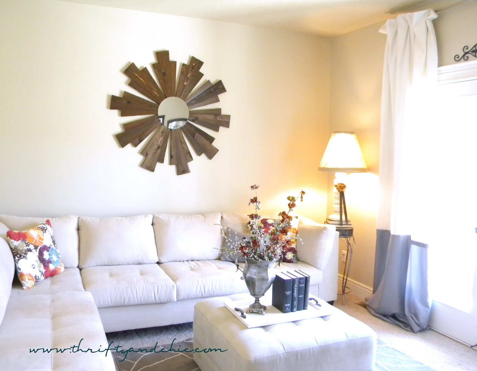 Beautiful wooden sunburst mirror in a simplistic living room