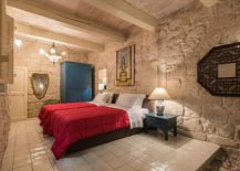 Bedroom-of-the-second-suite-with-traditional-antique-Maltese-tiles-stone-walls-and-pops-of-red-and-blue-217x155