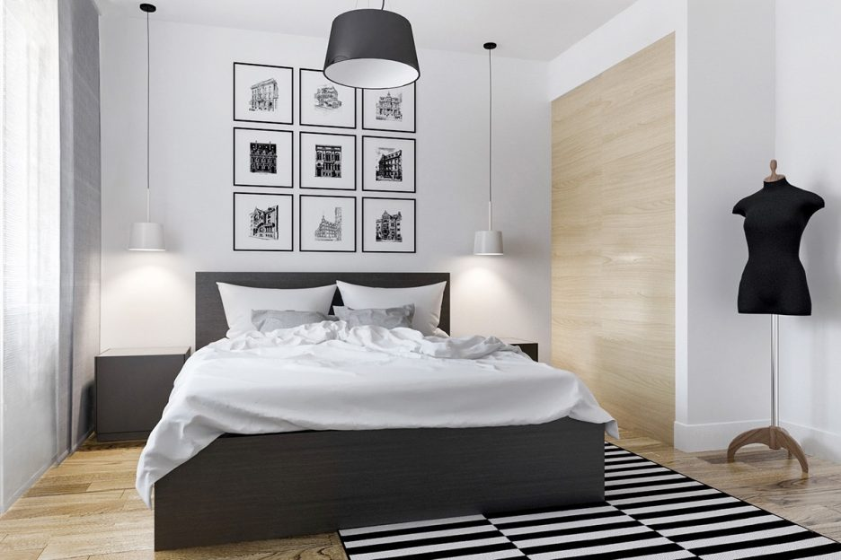 Bedroom with a simple decor and a dynamic monochrome rug
