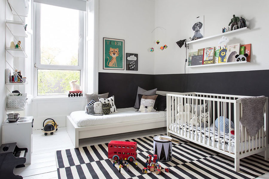 Big monochrome nursery with a striped rug