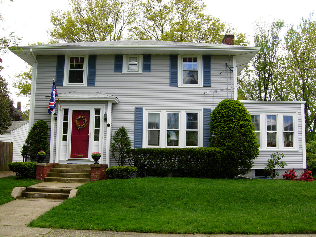 Big suburban house with a red door that stands out