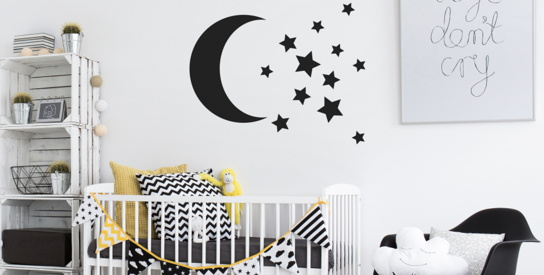 Black and white elements complement each other in this monochrome nursery