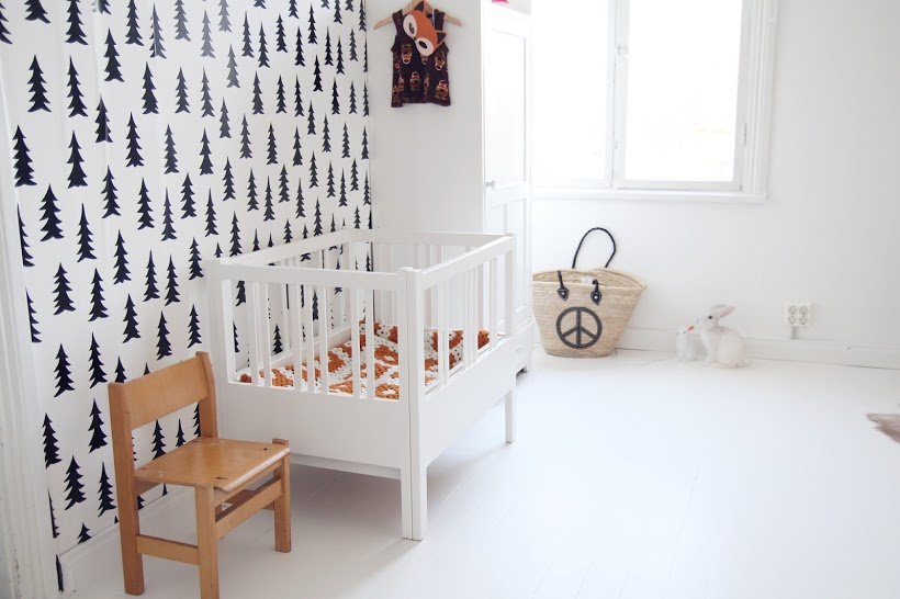 Black and white nursery with a few subtle wooden decor elements