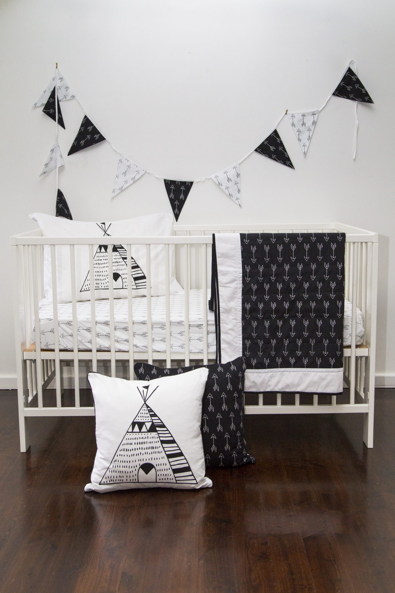 Black and white nursery with hardwood floors