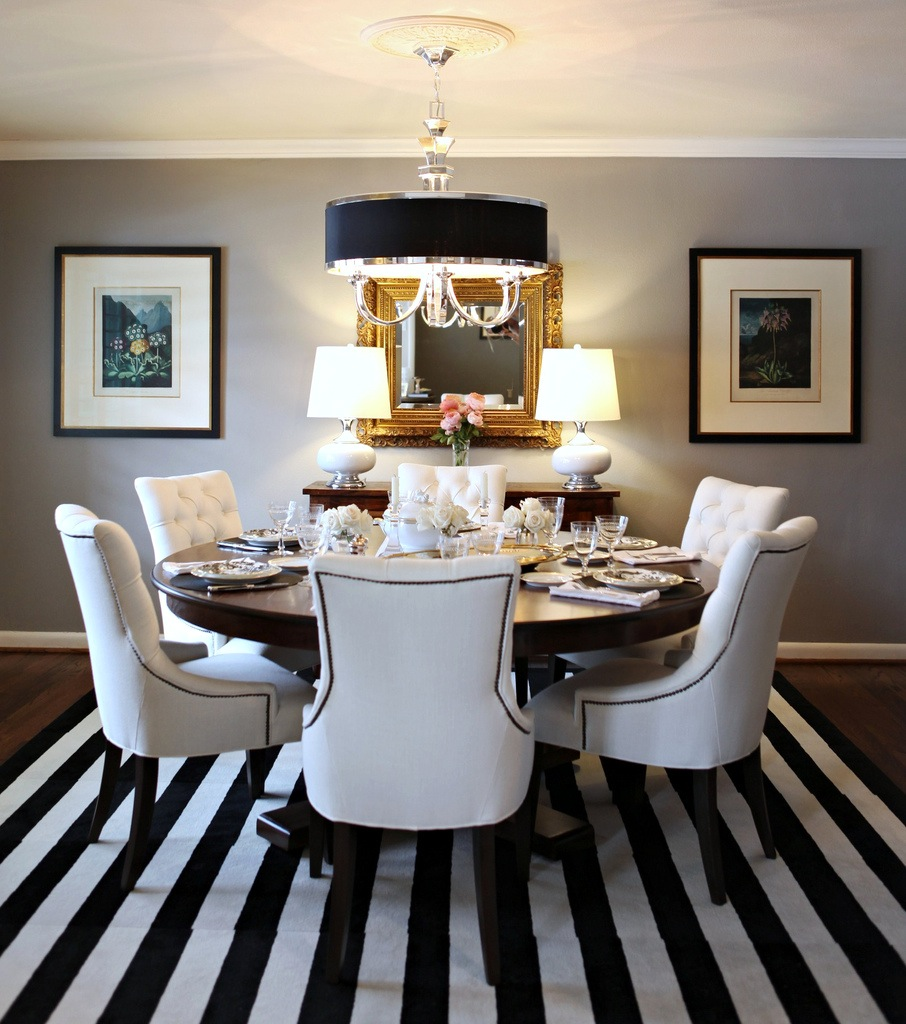 Black and white striped rug in a balanced and graceful dining room