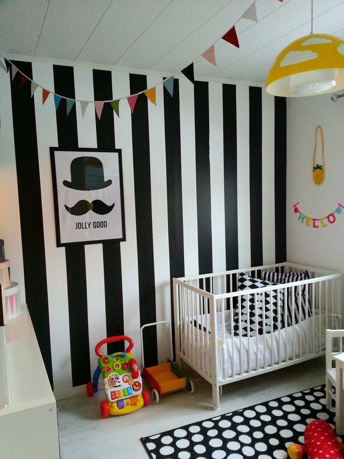 Black and white striped wall defines the whole nursery