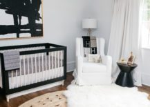 Black-crib-surrounded-by-bright-decor-pieces-217x155