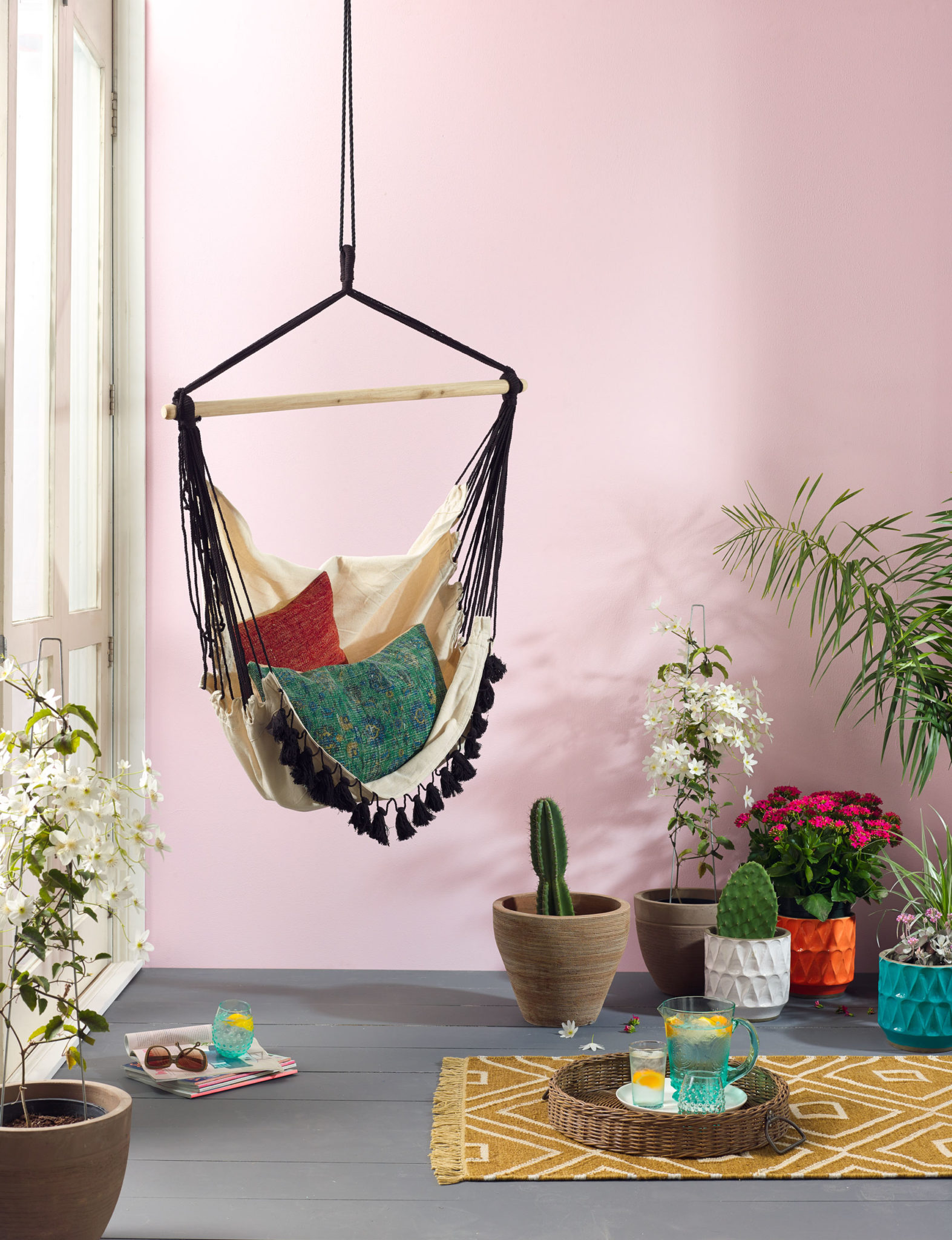 Bohemian hammock chair in a pastel room