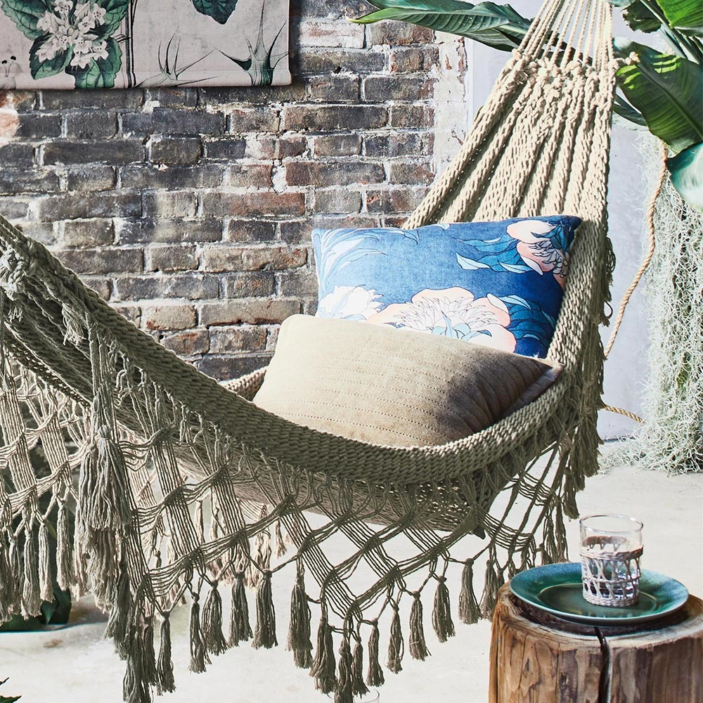 Bohemian-hammock-in-a-neutral-color-with-a-fun-fringe-