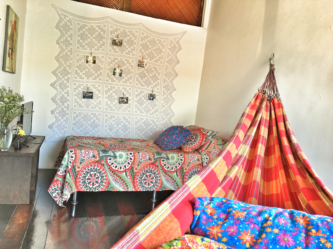 Bohemian hammock in bright and cheerful shades of red