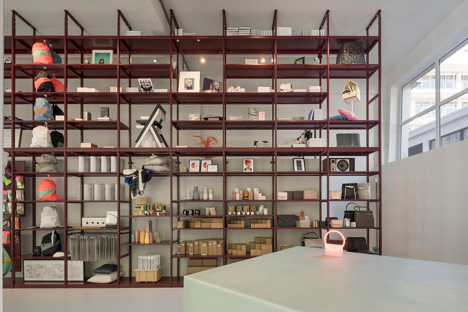 Bright red shelves display the best art and craft creations of the city
