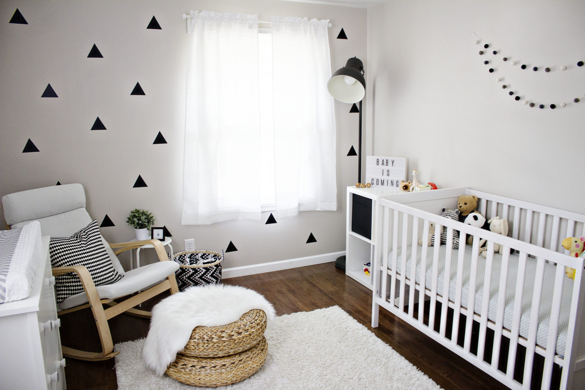 Bright white nursery with selected black decor pieces