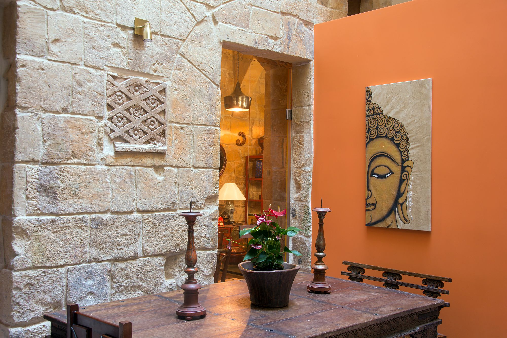 Carefully preserved and restored stone walls from early 1500s inside the botique hotel