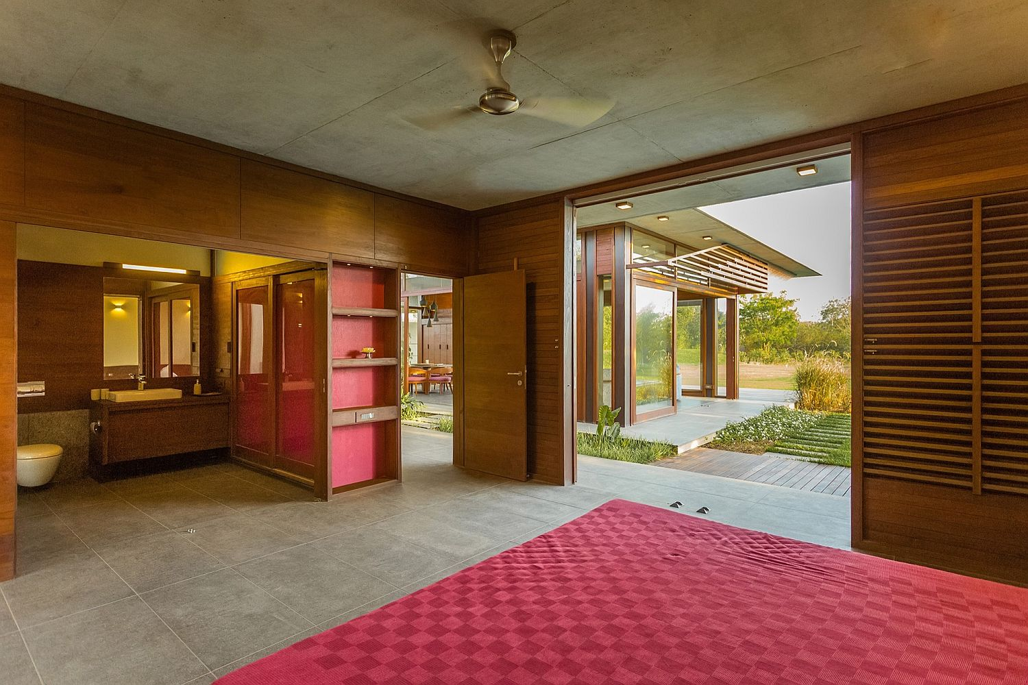 Carpet and curtains bring red into the resort-style retreat
