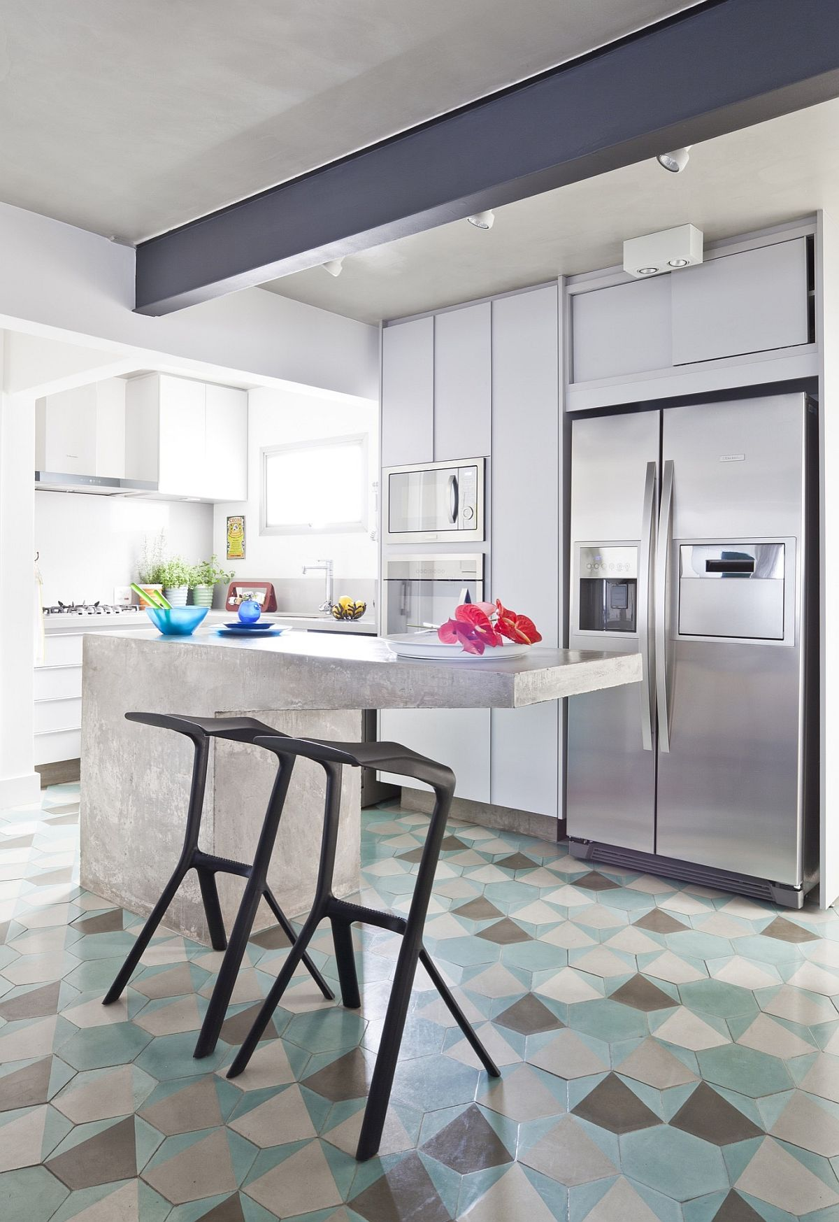 Cement kitchen island and cement colored ceiling for the indoors