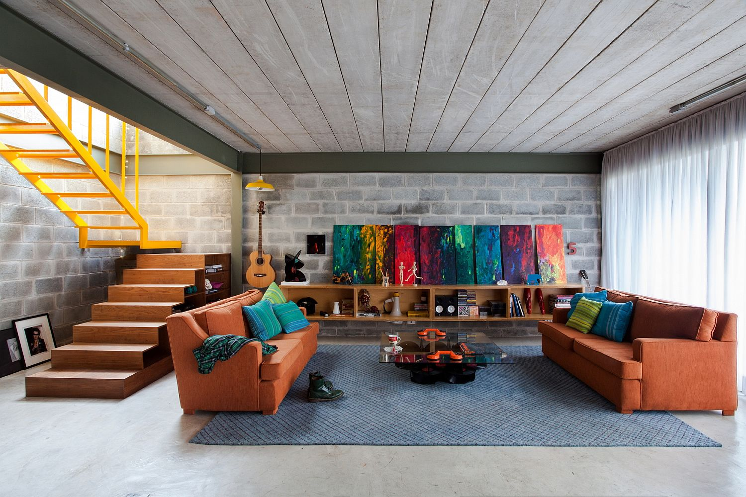 Cement walls and concrete blocks shape a light filled interior Cement and Concrete Brazilian Home is Energized with Bright Color