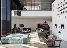 Central double height living area with ample lighting 217x155 LA House: Cantilevered Brilliance Wrapped in Concrete and Wood