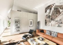 Central living area with curated decor and interesting wall art 217x155 Swiss Delight: Modern Single Family House in Concrete and Wood