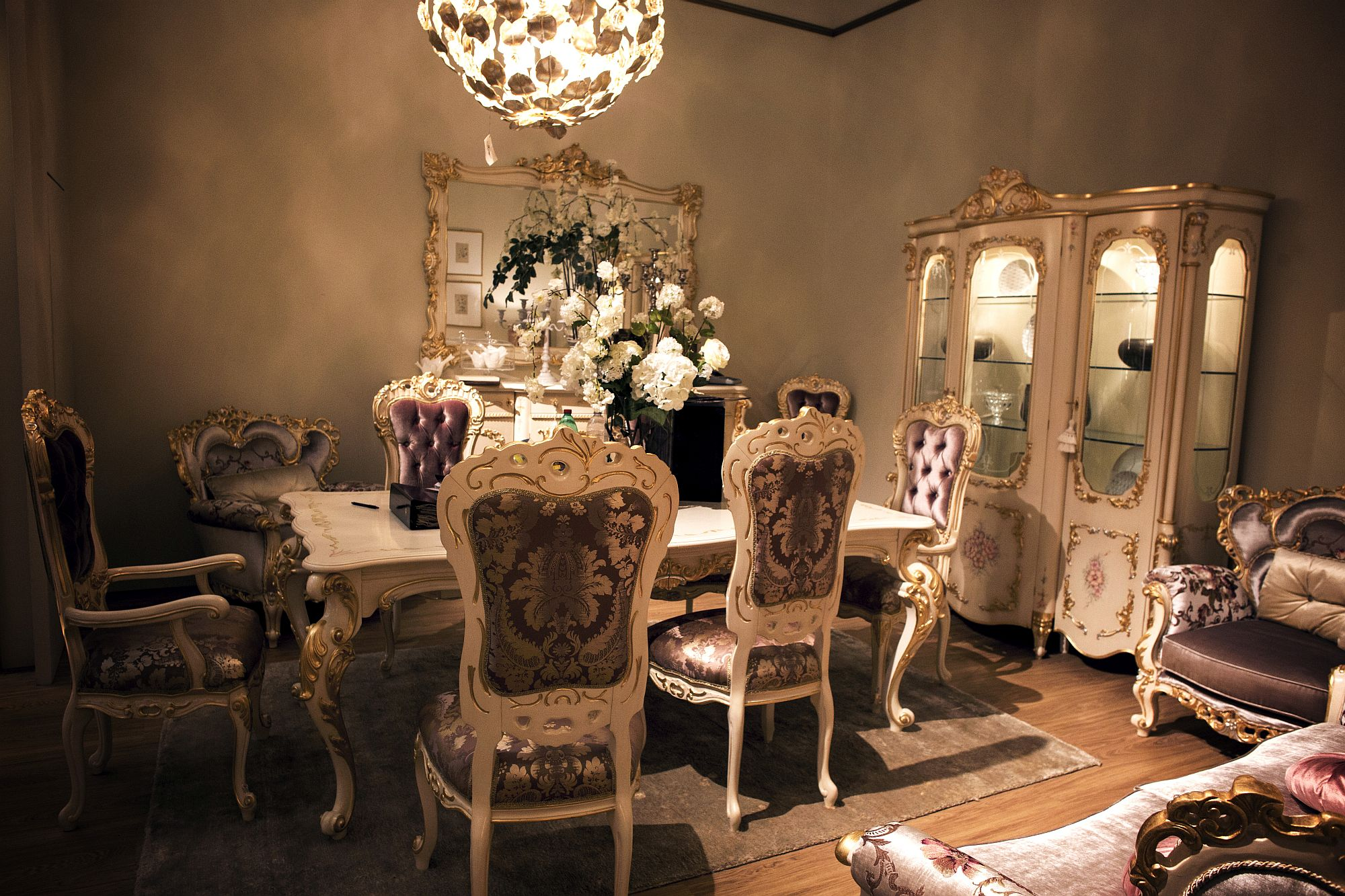 Classic cabinet, dining table chairs and a hint of purple for the exquisite dining room