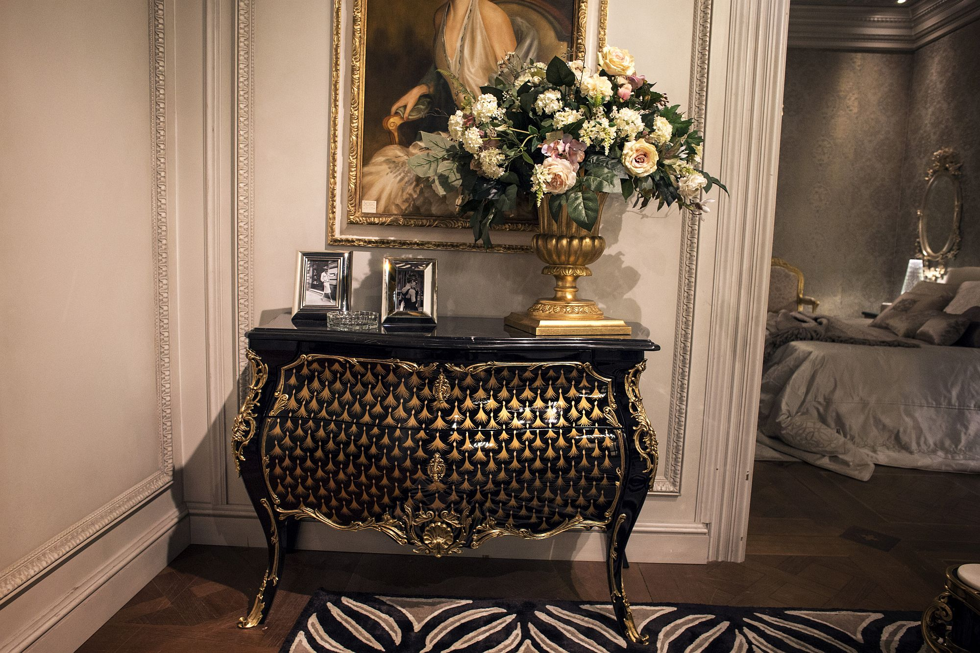 Classic entry console table in balck and gold decorated beautifully