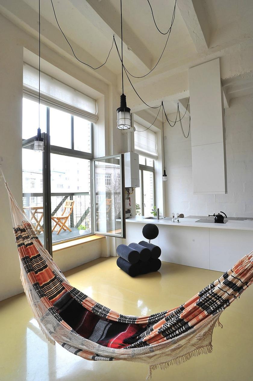 Colorful bohemian hammock in a minimalist room