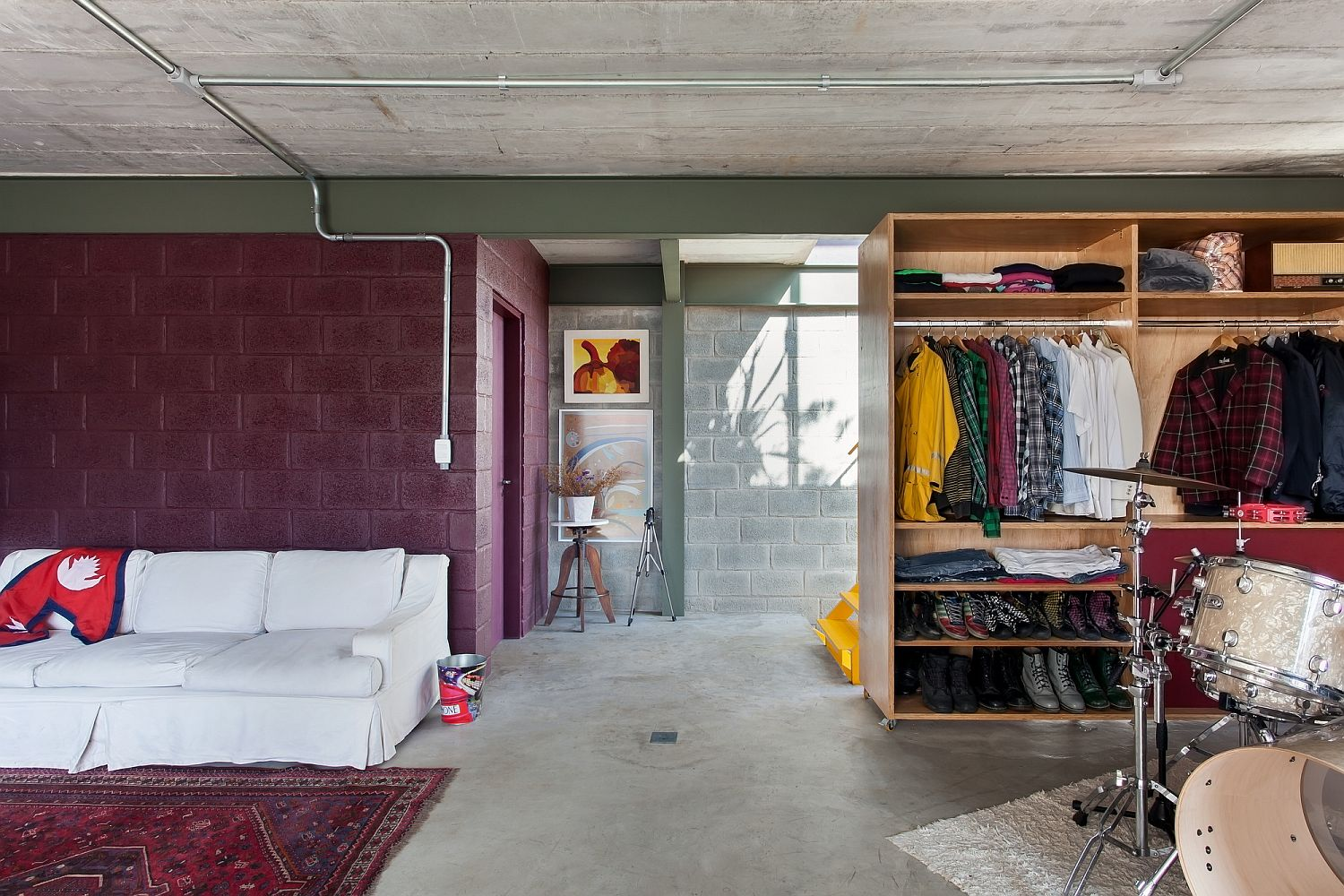 Colorful cement blocks and open wardrobe for the bedroom