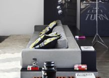 Comfy-couch-in-gray-with-tripod-floor-lmap-next-to-it-217x155