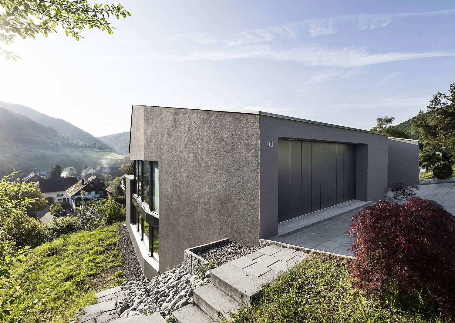 Swiss delight modern single family house in concrete and wood for Cmu home