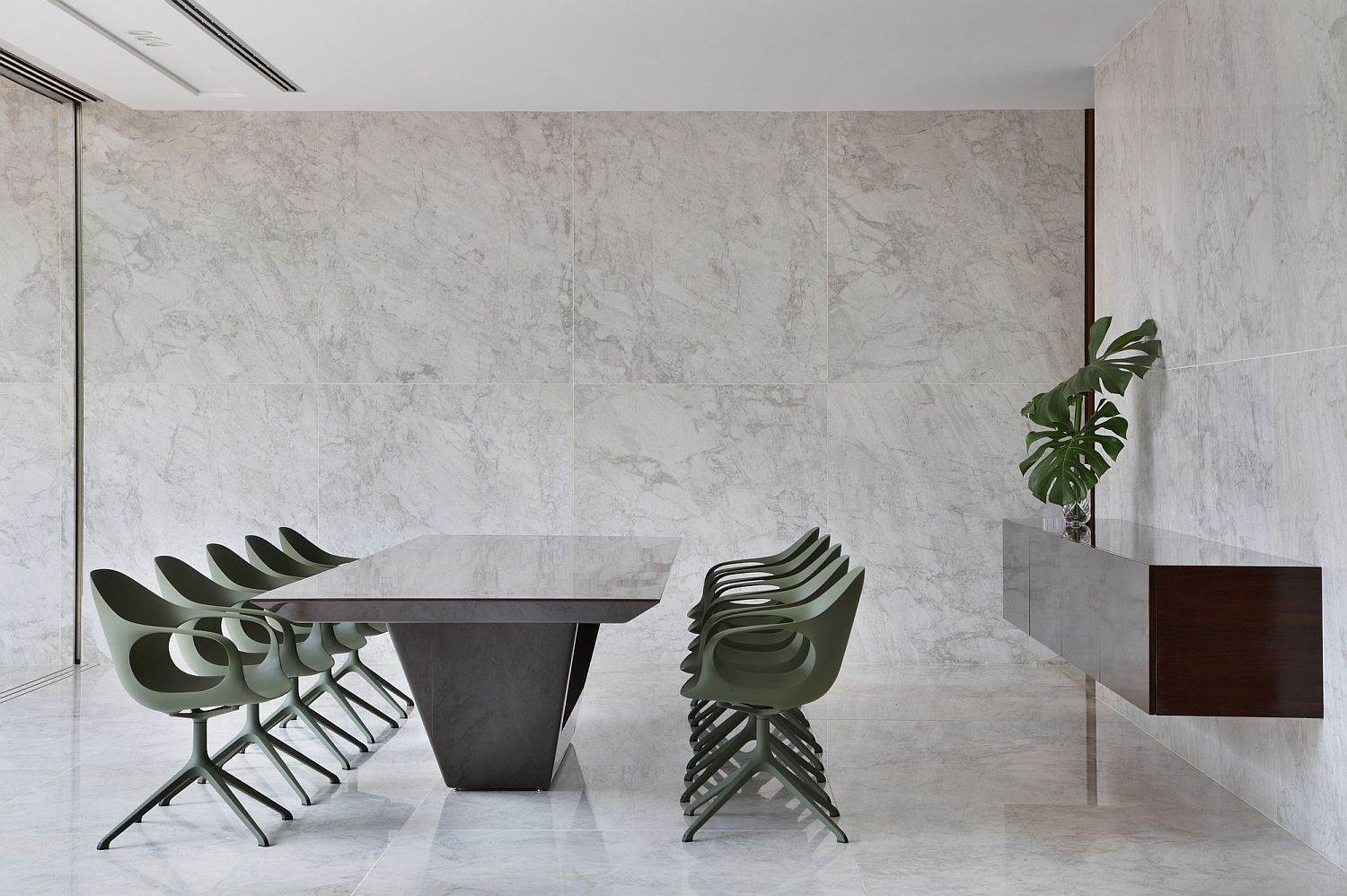 Contemporary minimal dining area with chairs in light pastel green