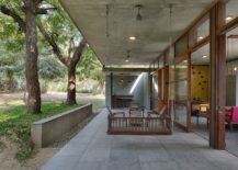 Covered-patio-outside-the-relaxing-pavilion-style-house-217x155