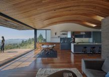 Curved form the ceiling and the tube bring in cool natural breeze 217x155 Wood Tube and Curved Ceiling Shape Skyline House Atop Eastbay Mountain Range