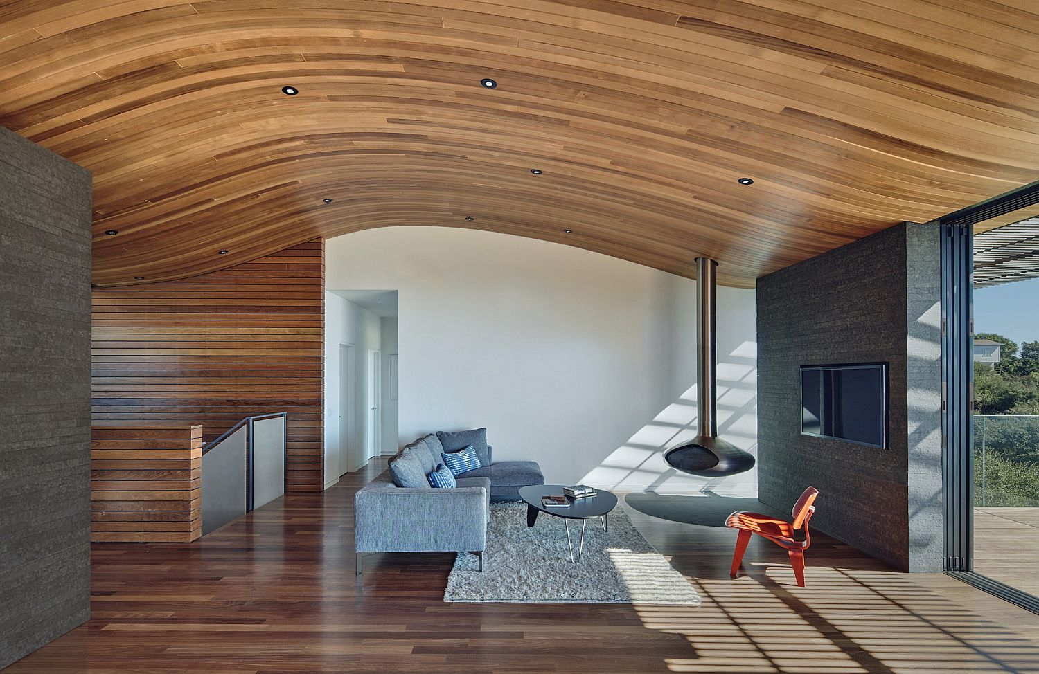 Curved wooden ceiling steals the show at this mountaintop residence