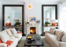 Custom made mirrors steal the show in this living room 217x155 Style, Space and Sparkle: Mirrors that Make a Statement