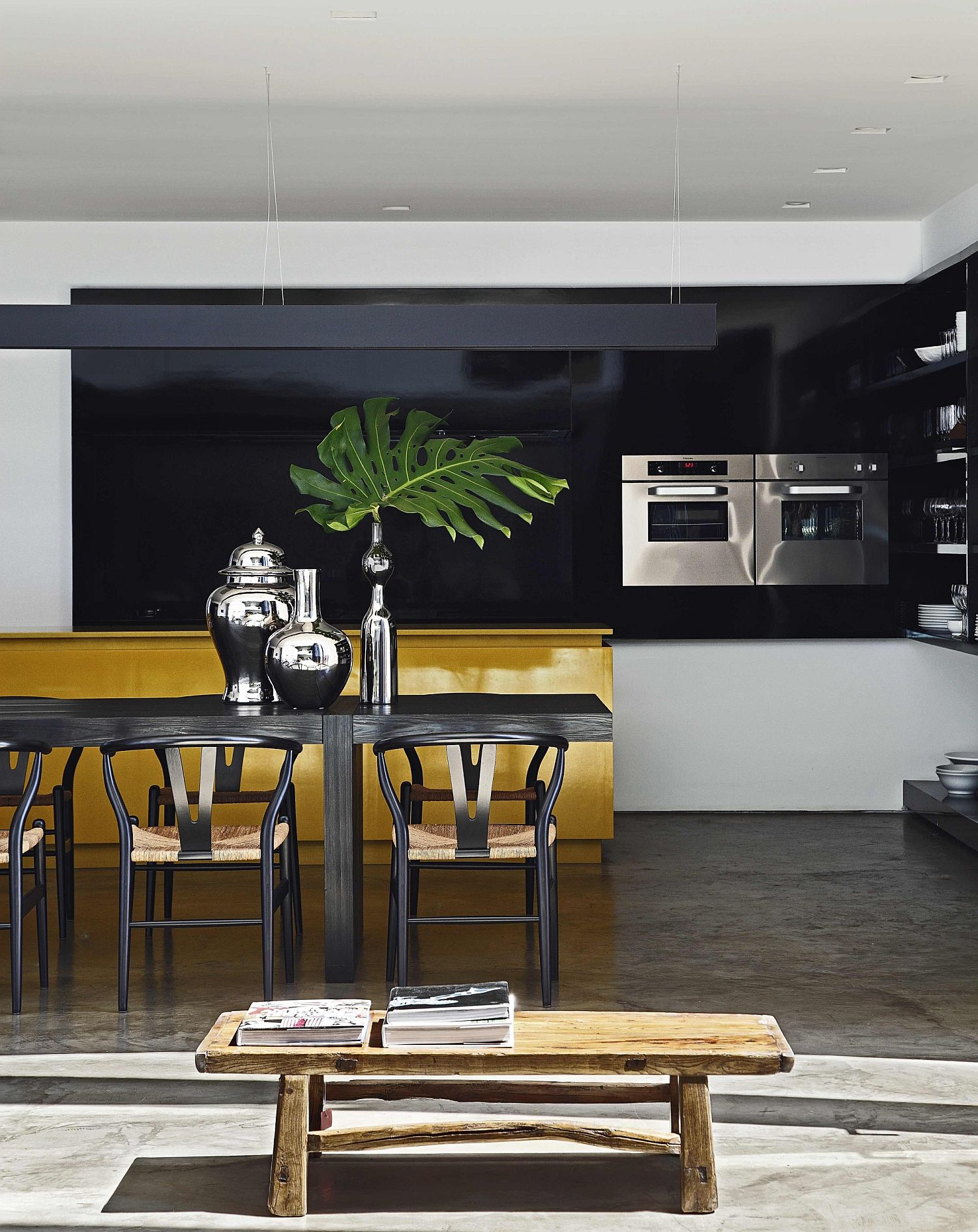 Dashing dining area and kitchen of contemporary Brazilian home