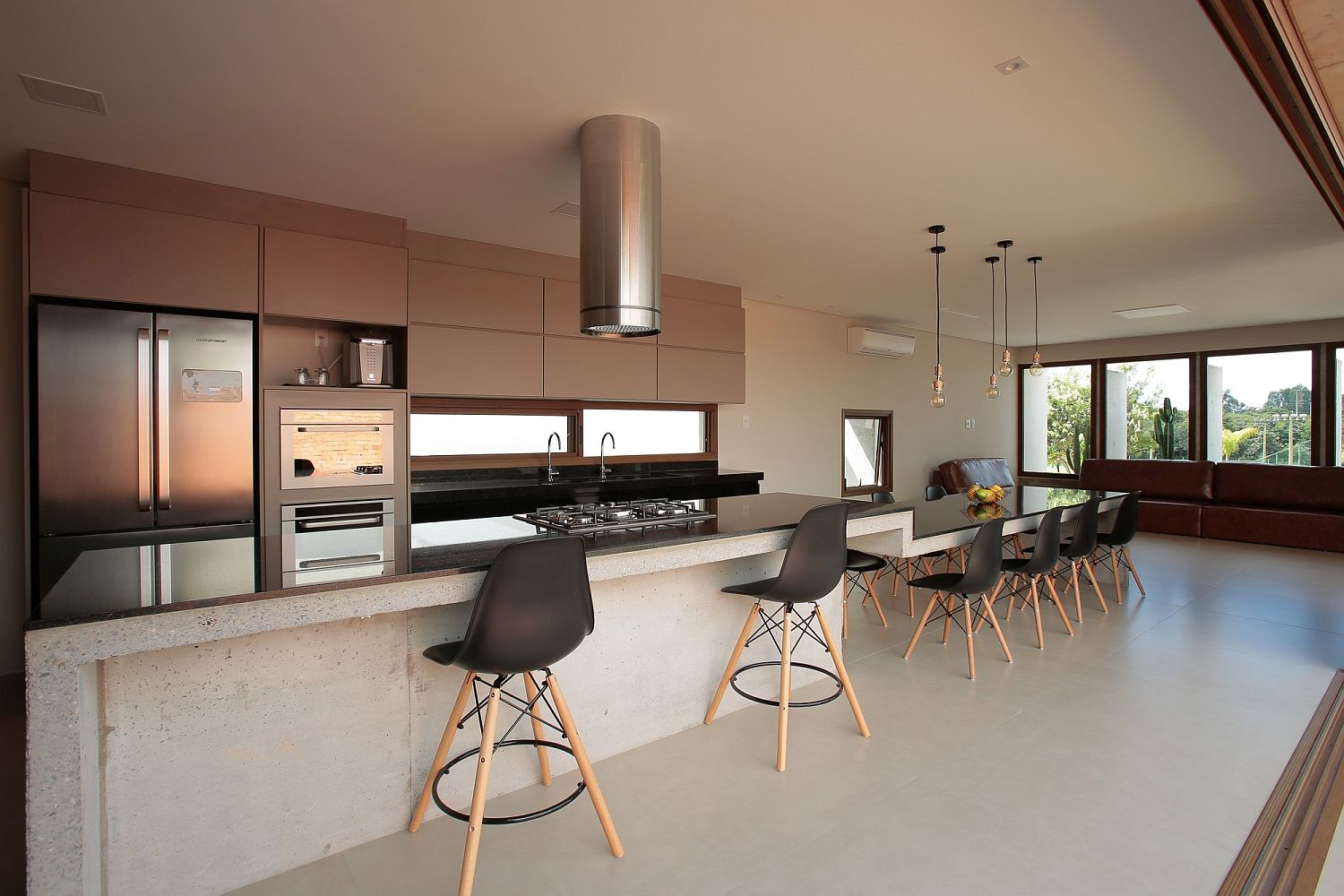 Eames chairs and bar stools for the kitchen and dining