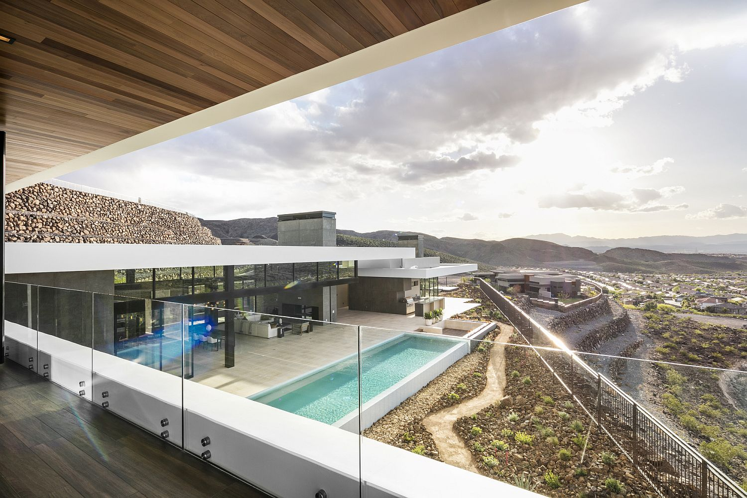 Elegant-landscape-and-pool-deck-viewed-from-the-top-level