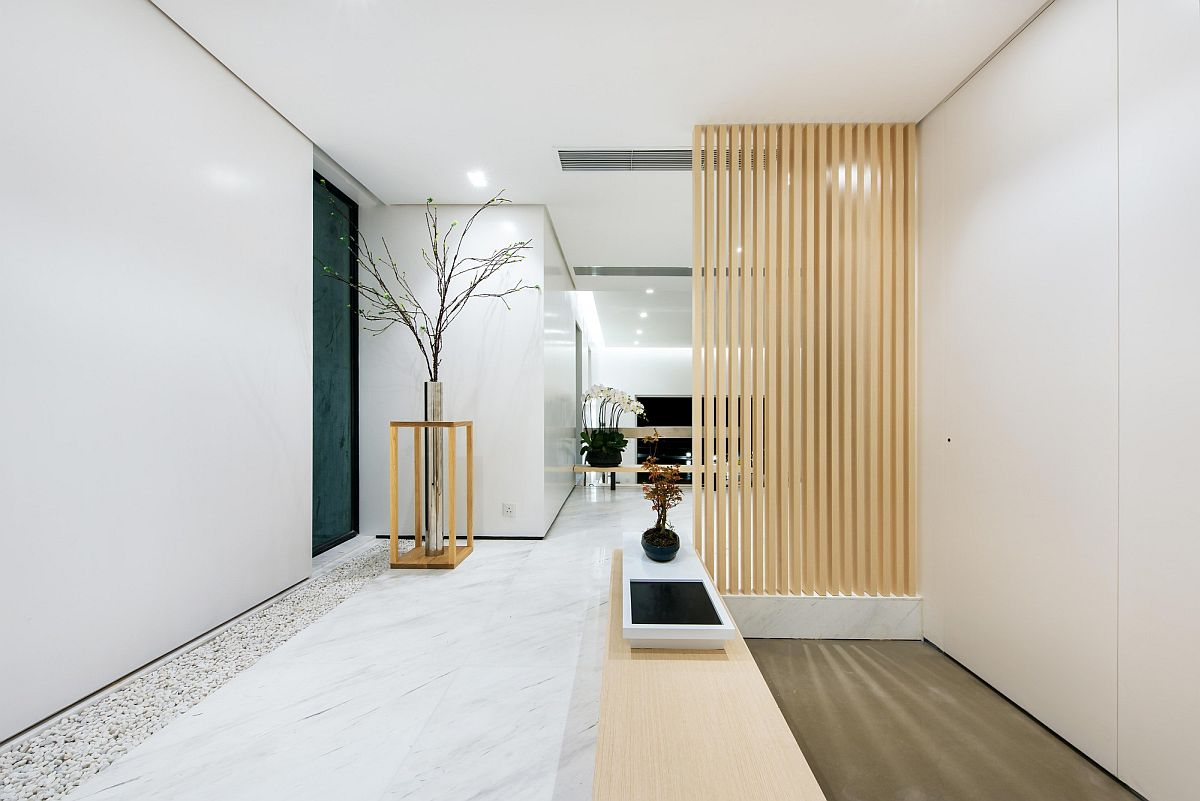 Entrance of the revamped contemporary home in Silverstrand Hong Kong Efficient Minimalism Meets Tranquil Ocean Views at House in Silverstrand