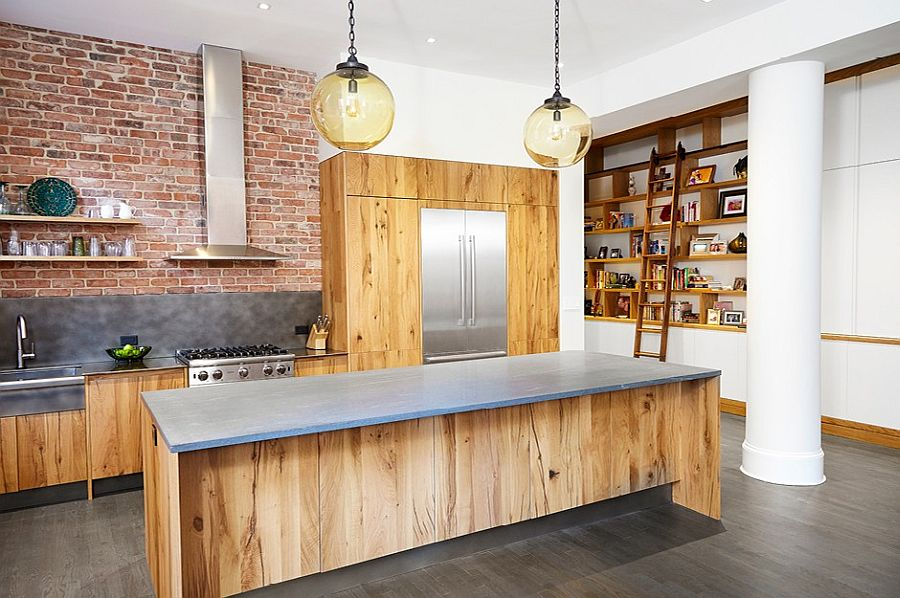 Exposed brick wall along with wooden island and shelves gives the kitchen plenty of contrast