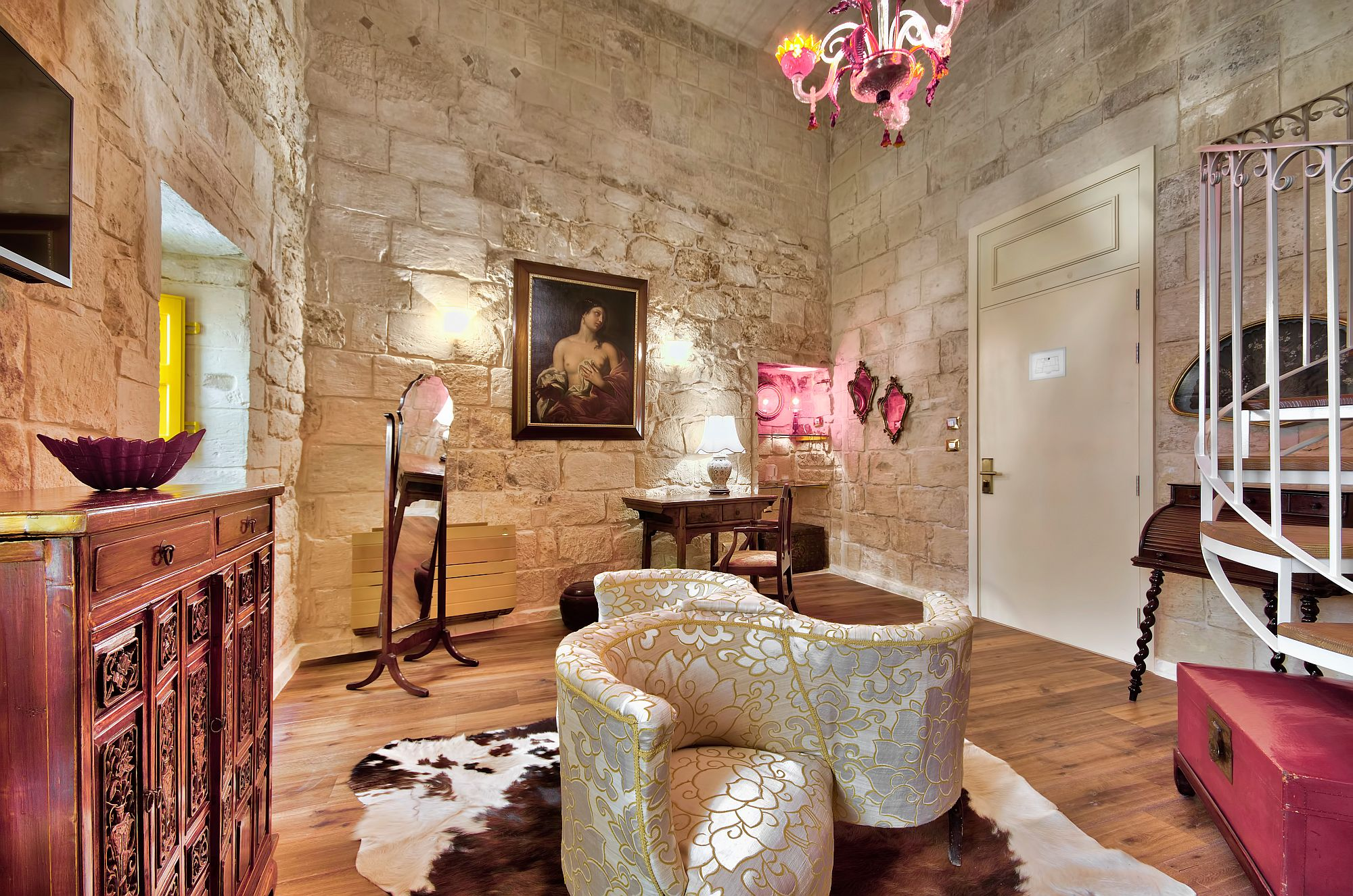 Exquisite collection of rare decor and art pieces inside Suite One of Locanda La Gelsomina