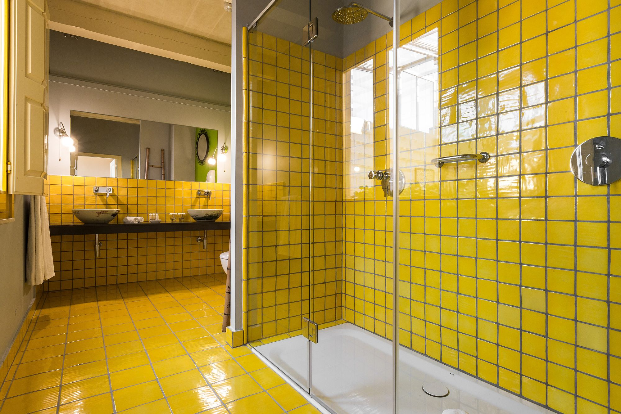 Fabulous bathroom draped in yellow tiles and filled with natural light