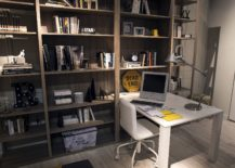 Floor-to-ceiling-wooden-shelving-next-to-the-ultra-slim-desk-in-the-kids-room-217x155