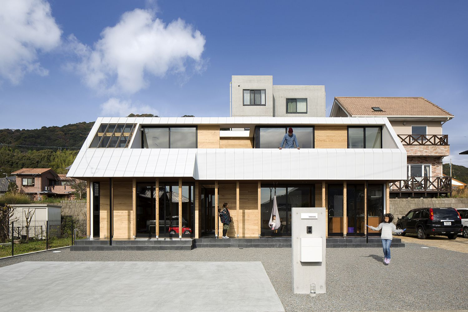 Front facade of the elegant modern family home in Japan This Light Filled Japanese Home is Built to Withstand Gusty Weather